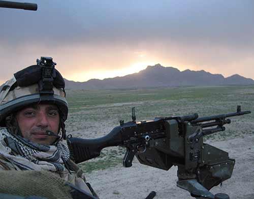 british soldier with machine gun in mountains